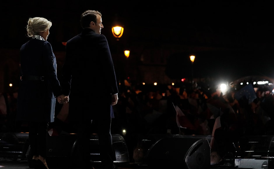 As the extent of his resounding victory sank in, Macron told a sea of jubilant supporters waving French flags outside the Louvre Museum in Paris,