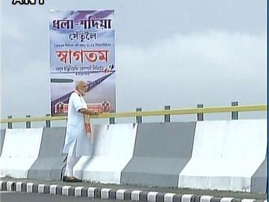 PM Modi inaugurating the Dhola-Sadiya Bridge. Courtesy: Twitter/@ANI