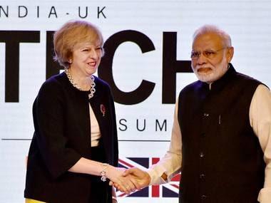 Prime Minister Narendra Modi and UK counterpat Theresa May. PTI