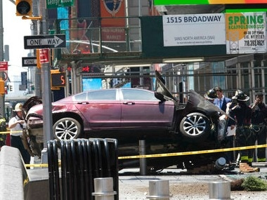 File photo of the car resting on security barriers after the crash. AP.