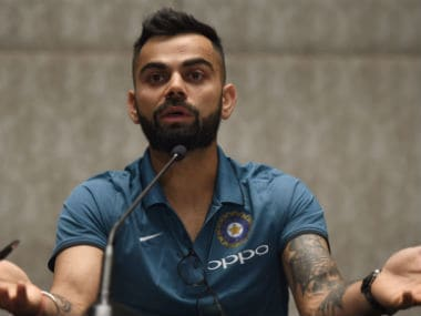 Virat Kohli interacting with the press in Mumbai before the team's departure for the Champions Trophy. AFP