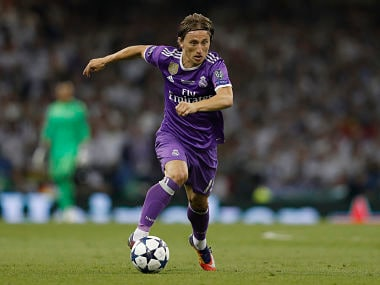 Real Madrid's Croatian midfielder Luka Modric runs during the UEFA Champions League final football match between Juventus and Real Madrid at The Principality Stadium in Cardiff, south Wales, on June 3, 2017. / AFP PHOTO / Adrian DENNIS