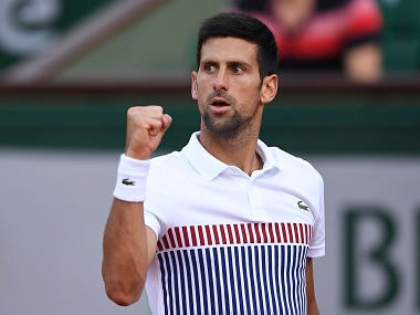 Serbia's Novak Djokovic celebrates after winning a point against Spain's Albert Ramos-Vinolas during their tennis match at the Roland Garros 2017 French Open on June 4, 2017 in Paris. / AFP PHOTO / Eric FEFERBERG
