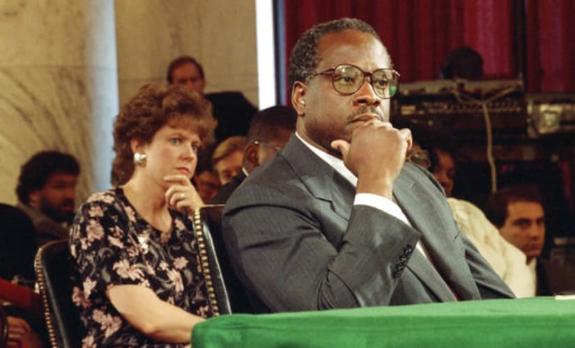 Supreme Court justice nominee Clarence Thomas and his wife Virginia listen during his nomination hearing before the Senate Judiciary Committee on Capitol Hill in Washington. AP