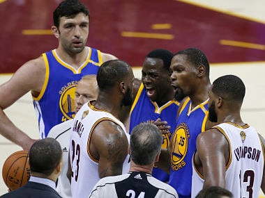 Cleveland Cavaliers forward LeBron James (23) argues with Golden State Warriors' Draymond Green (23) and Kevin Durant (35) during the second half of Game 4 of basketball's NBA Finals in Cleveland, Friday, June 9, 2017. (AP Photo/Ron Schwane)