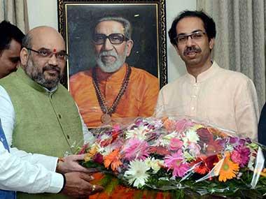 File image of Shiv Sena president Uddhav Thackrey and BJP chief Amit Shah. PTI