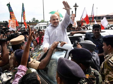 BJP chief Amit Shah waves at supporters on his arrival at Cochin International Airport on Friday for a three-day visit to Kerala. PTI