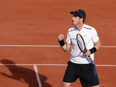 Andy Murray clenches his fist as he defeats Japan's Kei Nishikori in their quarter-final. AP