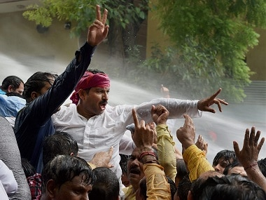 Delhi BJP chief Manoj Tiwari along with party workers holding a protest outside Chief Minister Arvind Kejriwal's residence. PTI