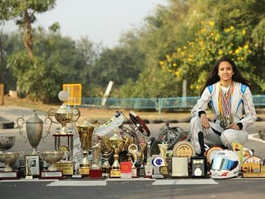 Mira Erda poses with her numerous awards. Image Courtesy: Twitter: @miraerda