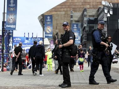 Security patrol the street in Cardiff prior to the Women's Champions League Final at the Cardiff City Stadium in Cardiff, Wales, Thursday June 1, 2017. The French side Lyon and PSG will play in the final later Thursday. (Nick Potts/PA via AP)