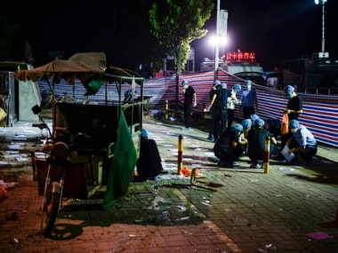 Photo released by China's Xinhua News Agency, investigators work early Friday, June 16, 2017, at the scene of an explosion outside a kindergarten in China. AP