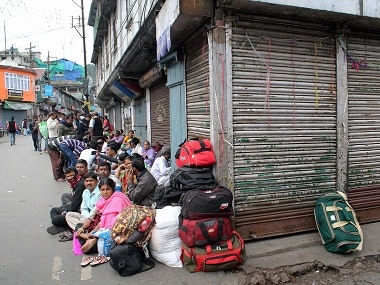 Tourists stranded following violent clashes in Darjeeling. PTI