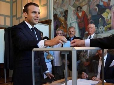 French President Emmanuel Macron casts his ballot. Reuters