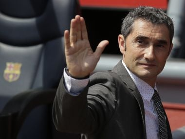 FC Barcelona's new signing coach Ernesto Valverde gestures during his official presentation at the Camp Nou stadium in Barcelona, Spain, Thursday, June 1, 2017. Former player Valverde was hired as the new coach, the club confirmed on Monday.(AP Photo/Manu Fernandez)