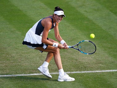 Spain's Garbine Muguruza in action against Russia's Elizaveta Kulichkova during their match. Reuters