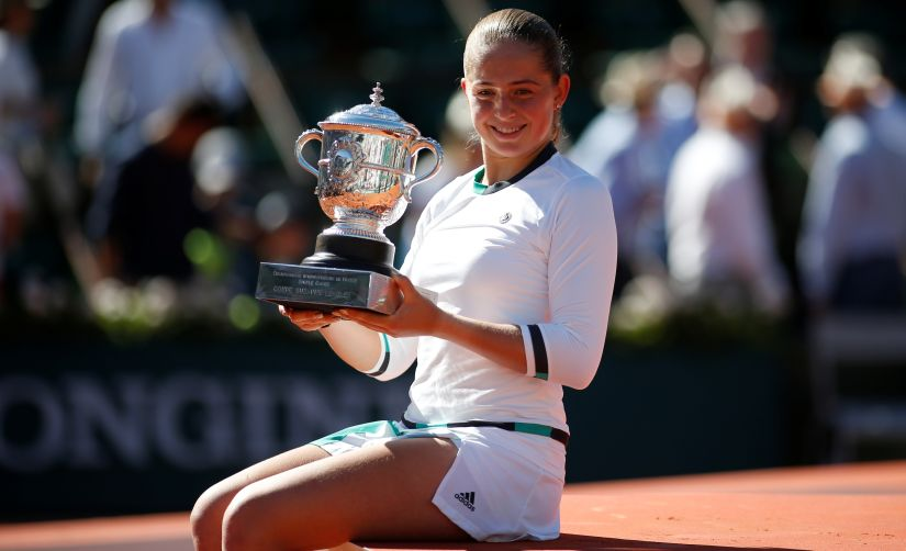 Latvia's Jelena Ostapenko celebrates with the trophy after winning the French Open final against Romania's Simona Halep. Reuters