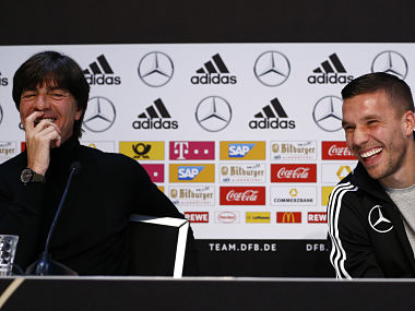 Germany's coach Joachim Loew and Lukas Podolski during a press conference. Reuters