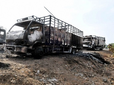 Farmers torched state bus and police vans. PTI