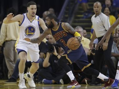 Kyrie Irving (2) tries to drives against Klay Thompson (11) during Game 1 of NBA Finals. AP