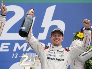 Porsche 919 Hybrid driver Nico Hulkenberg celebrates on the podium after winning the Le Mans 24-hour race in 2015. REUTERS