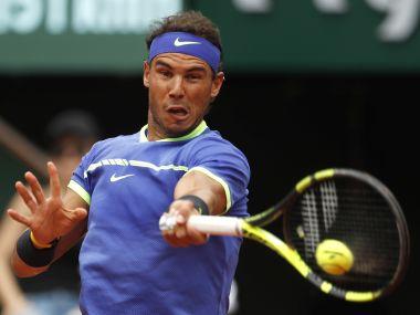 Rafael Nadal returns the ball to Nikoloz Basilashvili during their third round match of the French Open. AP