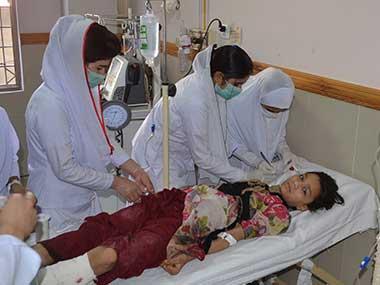 Pakistani nursing staff attend an injured girl at a hospital in Quetta, Pakistan. AP