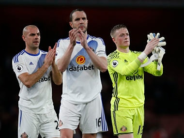 """Britain Football Soccer - Arsenal v Sunderland - Premier League - Emirates Stadium - 16/5/17 Sunderland's Jordan Pickford, Darron Gibson and John O'Shea applaud fans after the match Action Images via Reuters / Paul Childs Livepic EDITORIAL USE ONLY. No use with unauthorized audio, video, data, fixture lists, club/league logos or """"live"""" services. Online in-match use limited to 45 images, no video emulation. No use in betting, games or single club/league/player publications. Please contact your account representative for further details. - RTX364HX"""