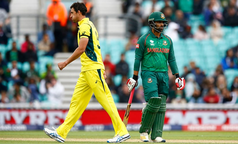 Bangladesh's Tamim Iqbal walks off after being dismissed by Australia's Mitchell Starc (L). Reuters
