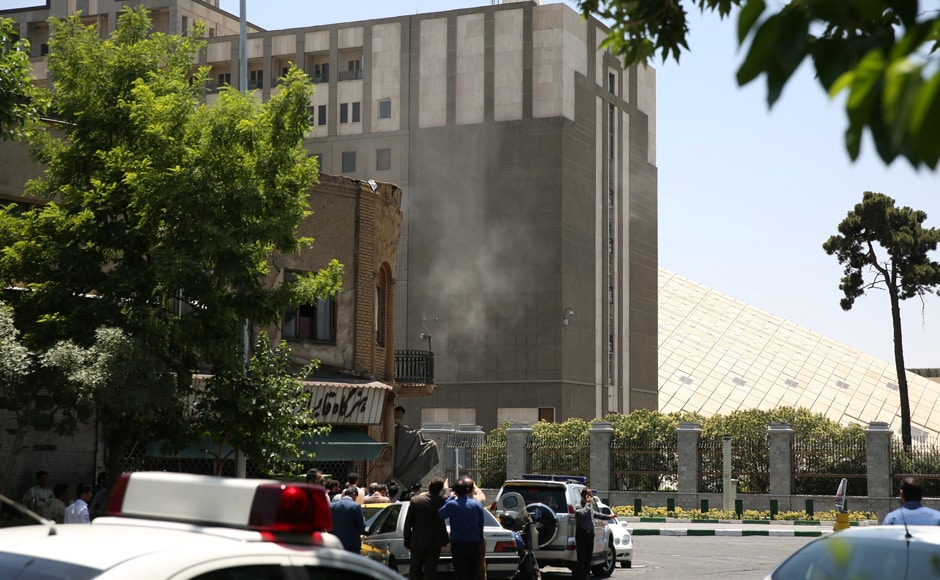 Smoke emanates at the Parliament building in central Tehran of Iran on Wednesday. Tima via Reuters