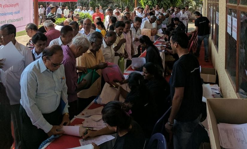 Senior citizens register their names at a job fair organised for them by Nightingales Empowerment Foundation. NEF and Janalakshmi Financial Services