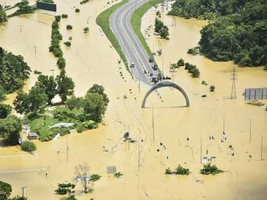 This Sunday, May 28, 2017 handout photo released by Sri Lanka Air Force shows a road submerged in floodwaters in Sri Lanka. Helicopters searched for people still marooned after rain-triggered floods and mudslides inundated villages last Thursday, killing more than 150 and leaving at least 100 others missing, officials say. (Sri Lanka Air Force via AP)
