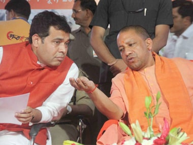 Uttar Pradesh Chief Minister Yogi Adiyanath along with state power minister, Shrikant Sharma, at an event in Allahabad. PTI