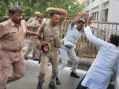 Police in action against Samajwadi Party's students wing members who showed black flags to the fleet of UP chief minister Yogi Adityanath. PTI