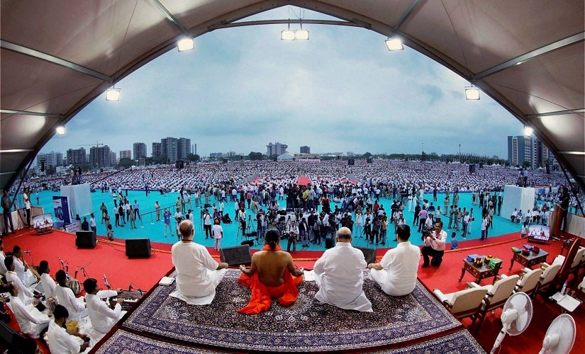 File image of Ramdev and others take part in a mass yoga session in Ahmedabad. PTI