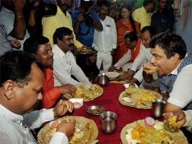 File image of Union minister Nitin Gadkar having a meal at a Dalit family's house in Ranchi. PTI.