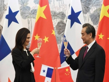Panama's foreign minister Isabel de Saint Malo and her Chinese counterpart Wang Yi . AP