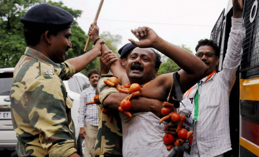 Police detain NCP farmers during a protest as part of their Maharashtra bandh over various demands, in Nagpur on Monday. PTI