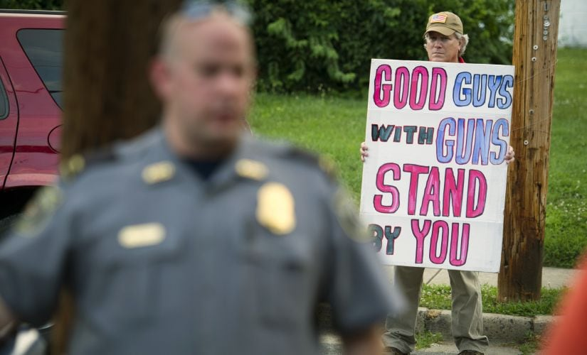 People came out in large numbers to support the victims of Virginia shootout. AP