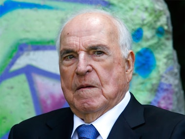 The May 16, 2014 photo shows former German Chancellor Helmut Kohl in front of a piece of the Berlin Wall in Kohl's garden in Oggersheim near Ludwigshafen, Germany. AP