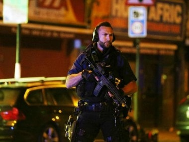 A police personnel stands guard at the mosque site. Reuters