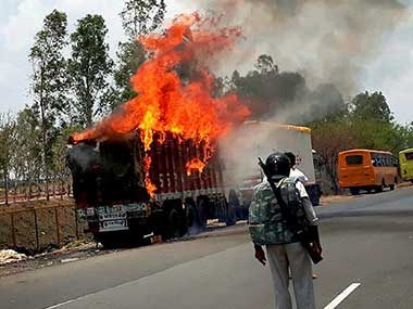 Farmers torch vehicles during a protest in Phanda near Bhopal, Madhya Pradesh on Friday. PTI