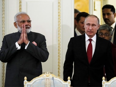 Indian prime minister Narendra Modi (left) and Russian president Vladimir Putin (right) arrives to attend a meeting with businessmen at the St. Petersburg International Economic Forum in St. Petersburg. AP