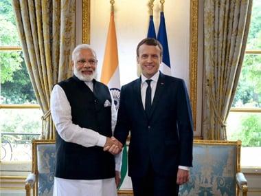 File image of Narendra Modi and Emmanuel Macron. PTI