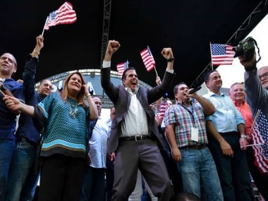 Puerto Rican governor Ricardo Rossello (C) celebrates after learning about the referendum. AP