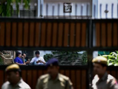New Delhi: Policemen stand guard as a CBI team visits Delhi Deputy CM Manish Sisodia's residence in New Delhi on Friday. The CBI visit was in connection with a preliminary enquiry against Sisodia related to the alleged irregularities in the Aam Aadmi Party's 'Talk to AK' campaign. PTI