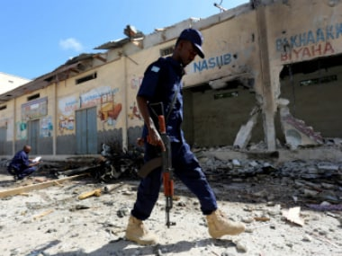 A Somali policeman walks through a scene where a car exploded in the Hamarweyne district in Mogadishu, Somalia (representational photo). Reuters