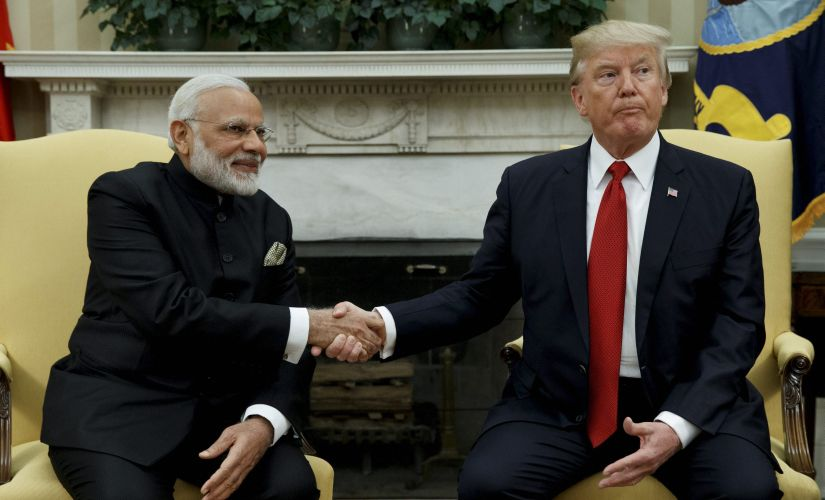 President Donald Trump shakes hands with Prime Minister Narendra Modi during their meeting in the Oval Office of the White House in Washington on Monday. AP