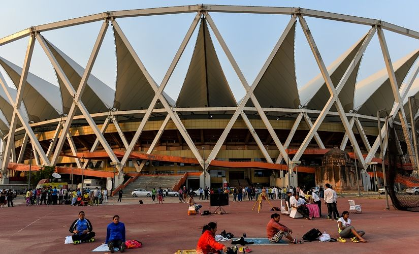In this photograph taken on April 29, 2016, Indian athletes rest as they prepare to compete in the women's discus event of The 20th Federation Cup National Senior Athletics Championship at The Jawaharlal Nehru Stadium in New Delhi. / AFP PHOTO / CHANDAN KHANNA