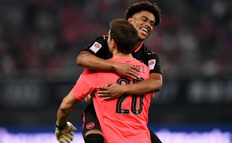 Arsenal player Reiss Nelson and Arsenal's goalkeeper Emiliano Martinez reacts after the penalty shoot out during the International Champions Cup football match between Bayern Munich and Arsenal in Shanghai July 19, 2017. / AFP PHOTO / Johannes EISELE